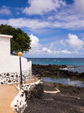 Punta Mujeres Village, Lanzarote, Canary Islands, Spain. Promenade and rocky cove at the seaside resort of Punta Mujeres, Lanzarote, Canary Islands, Spain Royalty Free Stock Photos