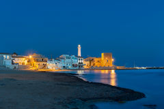 Punta Secca at blue hour. A view of Punta Secca, a small fishing village in the province of Ragusa, at blue hour Stock Photography