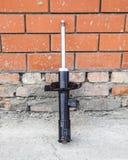 Puntal del coche Amortiguador de choque delantero de un coche imagen de archivo
