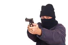 Puntería del ladrón un arma fotos de archivo