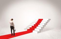 Punti al concetto di successo con l'uomo d'affari Immagine Stock