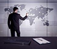 Punti del disegno dell'uomo d'affari sulla mappa di mondo Fotografia Stock