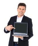 Punti dell'uomo d'affari al computer portatile Immagine Stock