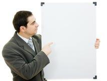 Punti dell'uomo d'affari alla scheda bianca Fotografie Stock