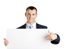 Punti dell'uomo di affari allo spazio della copia su carta Fotografia Stock