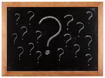Punti interrogativi sulla lavagna Immagini Stock