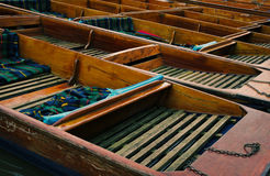 Punting boats lined up on river Royalty Free Stock Image