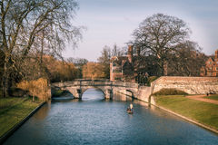 Punting @Cambridge. Punting at Cambridge. Landscape showing Cambridge river side and bridge Royalty Free Stock Photos