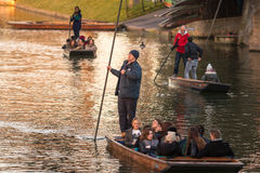 Punting. Cambridge, UK -- Feb 8, 2015: Groups of Tourism punting on the boats Royalty Free Stock Image