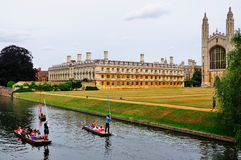 Punting in the Canals of Cambridge. This picture shows a three boats in a canal in Camebridge. King's College is shown in the background. The ships are propelled Stock Image