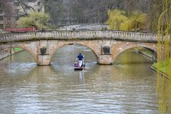 Punting on the river Cam in Cambridge, England. With cloudy sky royalty free stock photography