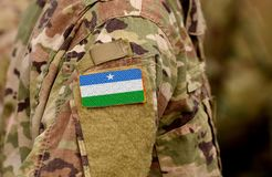 Puntland State of Somalia flag on soldiers arm. Puntland army c. Ollage royalty free stock photos