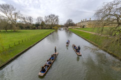 Puntng in river Cam. People punting in the river cam, cambridge UK stock image