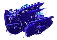 Punto de la pintura de aceite azul en un blanco imagen de archivo