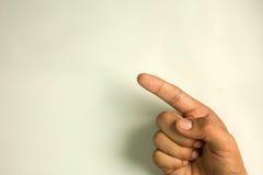 Punto del dito sullo schermo, fondo bianco isolato Immagine Stock