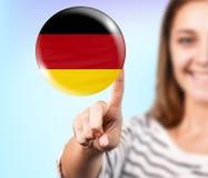 Punto della donna sulla bolla con la bandiera tedesca Immagine Stock Libera da Diritti