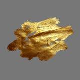 Punto della pittura del colpo della spazzola dell'oro del disegno della mano su un fondo grigio royalty illustrazione gratis