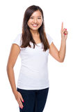 Punto di Singapore del dito della donna su Immagine Stock