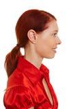 Punto di vista di profilo di una donna redhaired Fotografie Stock Libere da Diritti
