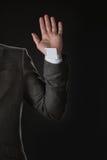 Punto di vista parziale dell'uomo d'affari con la carta del burlone in manica Fotografie Stock