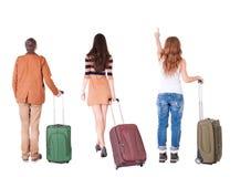 Punto di vista posteriore del gruppo con la valigia Immagini Stock