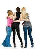 Punto di vista posteriore del gruppo di giovani donne felici Fotografia Stock