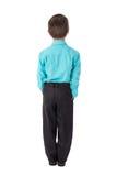 Punto di vista posteriore del ragazzino in vestito isolato su bianco Fotografia Stock