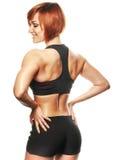 Punto di vista posteriore dell'atleta femminile di misura contro di fondo bianco fotografia stock