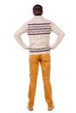 Punto di vista posteriore dell'uomo bello nel cercare caldo del maglione Immagine Stock