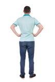 Punto di vista posteriore dell'uomo bello nel cercare della maglietta Fotografie Stock Libere da Diritti