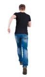 Punto di vista posteriore dell'uomo corrente tipo di camminata nel moto Fotografie Stock