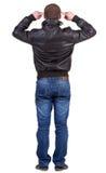Punto di vista posteriore dell'uomo di pensiero in rivestimento. Fotografia Stock
