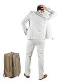 Punto di vista posteriore dell'uomo di viaggio di affari con la valigia Fotografie Stock
