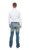 Punto di vista posteriore dell'uomo in jeans Immagine Stock