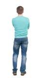 Punto di vista posteriore dell'uomo in jeans Giovane tipo diritto Fotografia Stock