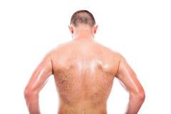 Punto di vista posteriore dell'uomo senza camicia fotografia stock libera da diritti