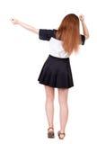 Punto di vista posteriore della donna allegra che celebra le mani di vittoria su Fotografia Stock Libera da Diritti