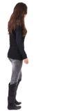 Punto di vista posteriore della donna andante in jeans e maglione Fotografia Stock Libera da Diritti