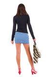 Punto di vista posteriore della donna andante nella donna del vestito con le borse di acquisto Immagini Stock Libere da Diritti
