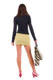 Punto di vista posteriore della donna andante nella donna del vestito con le borse di acquisto Immagine Stock
