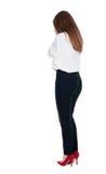 Punto di vista posteriore della donna colpita in pantaloni Fotografia Stock