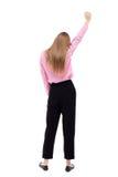 Punto di vista posteriore della donna di affari Ha alzato il suo pugno su in sig di vittoria Fotografia Stock Libera da Diritti