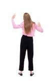 Punto di vista posteriore della donna di affari Ha alzato il suo pugno su in sig di vittoria Fotografia Stock