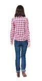 Punto di vista posteriore della donna di camminata in camicia a quadretti immagini stock libere da diritti