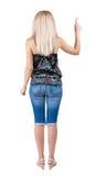 Punto di vista posteriore della donna indicante Immagini Stock Libere da Diritti