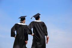 Punto di vista posteriore dello studente di laureati Fotografia Stock