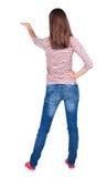Punto di vista posteriore di bella giovane donna castana sorpresa con la mano Fotografie Stock