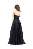 Punto di vista posteriore di giovane bella donna in vestito da sera nero fotografia stock