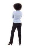 Punto di vista posteriore di giovane donna afroamericana di affari che posa isolat immagine stock