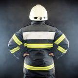 Punto di vista posteriore di un vigile del fuoco Fotografia Stock Libera da Diritti